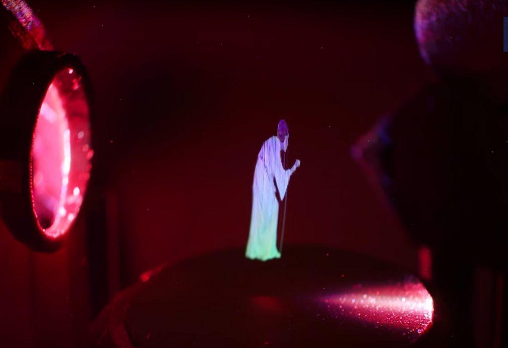 3D проектор, показывающий танцующие изображения